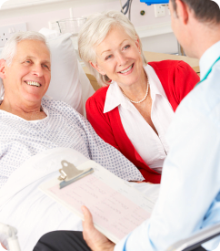 elderly couple talking with a doctor